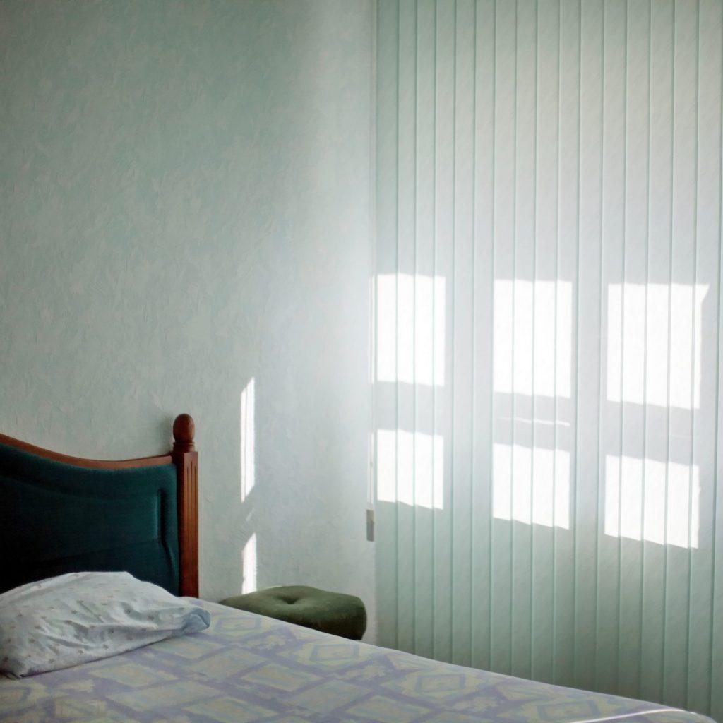 bed in a bright interior