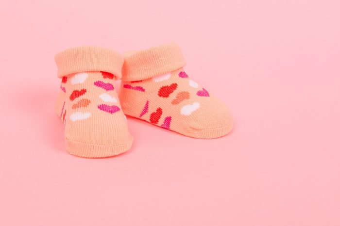 Baby socks with hearts on a pink background
