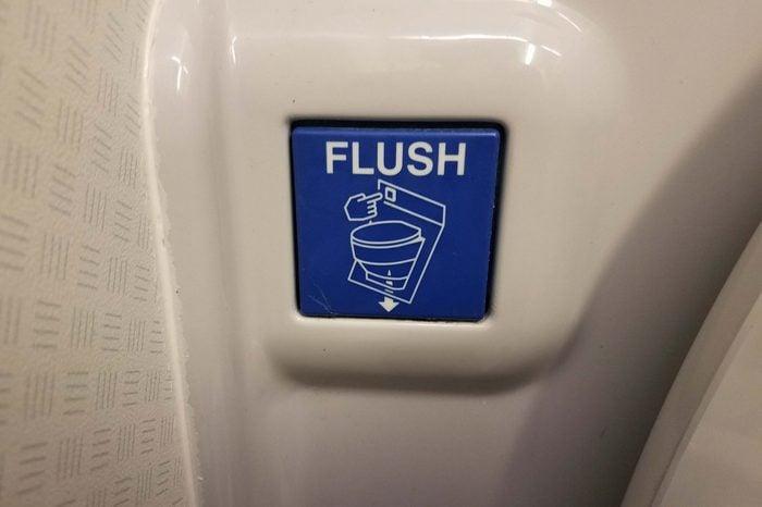 airplane bathroom toilet flush button