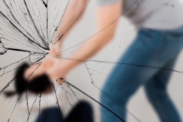 domestic violence, abuse and people concept - man beating helpless woman at home