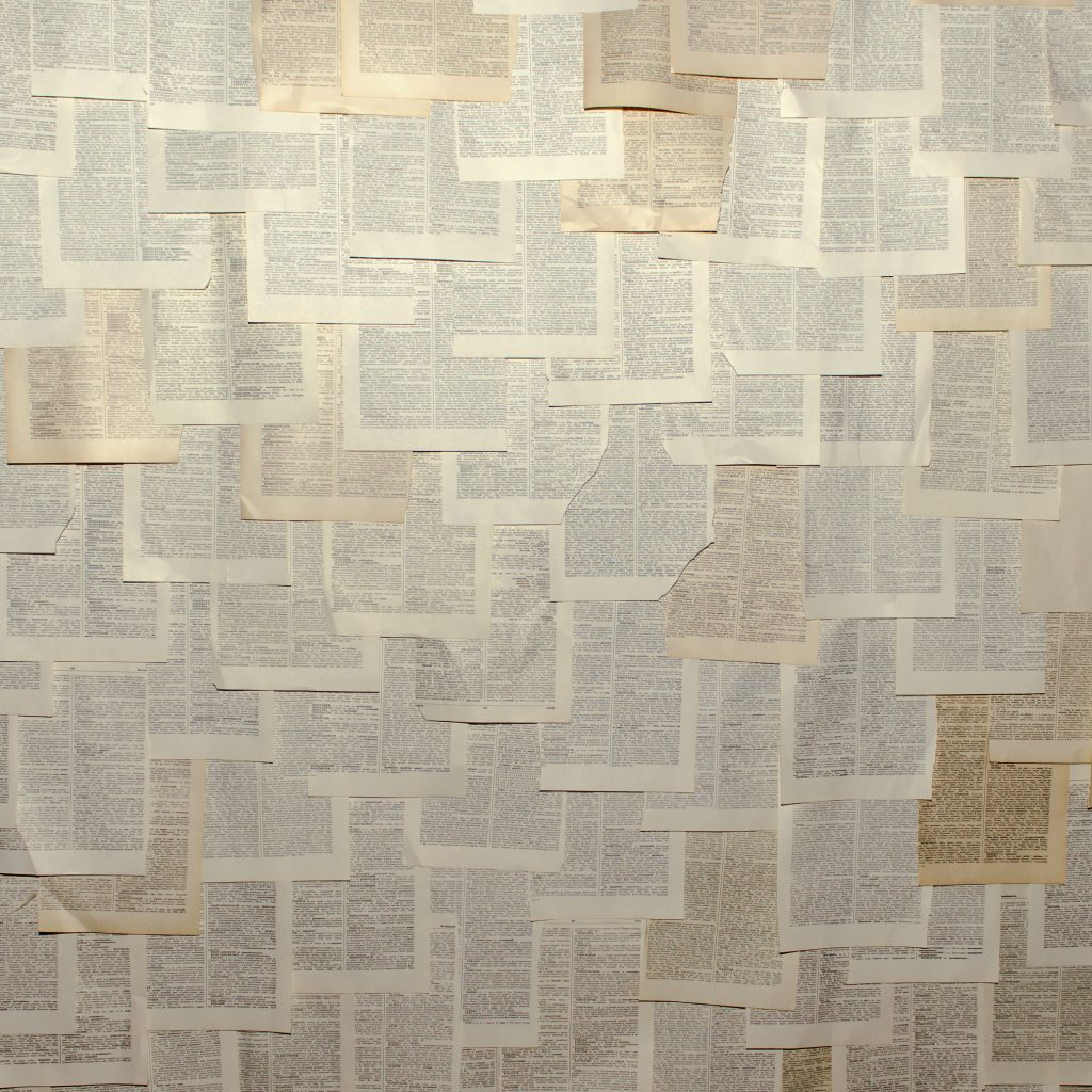 The old pages of the book are spread out and pasted over