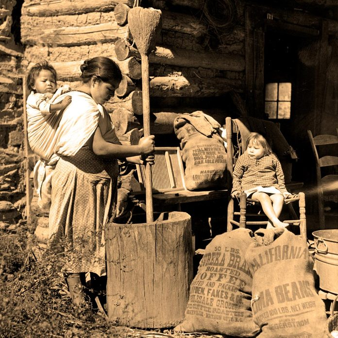 CHEROKEE INDIANS-Cherokee Indian woman cooking a meal on the Qualla Reservation in the Great Smokey Mountains.