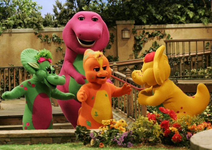 Mandatory Credit: Photo by Donna Mcwilliam/AP/Shutterstock (6376107a) Barney and Friends Riff, front, center, a new character on the Barney & Friends show, is shown with with the show's other dinosaur characters, Baby Bop, left, Barney, back, and B.J., right, during the taping of a new Barney episode at the Barney & Friends studio in Carrollton, Texas BARNEY AND FRIENDS, CARROLLTON, USA