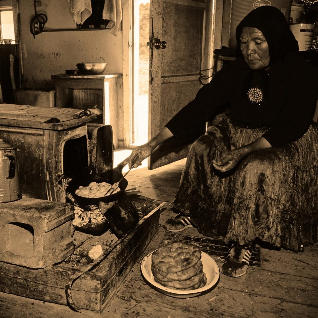 Mary Todecheeine is cooking 'frybread' in her house on the Black Mesa plateau in the heart of the Navajo Indian Nation. Black Mesa, Arizona, America. Mar 2007