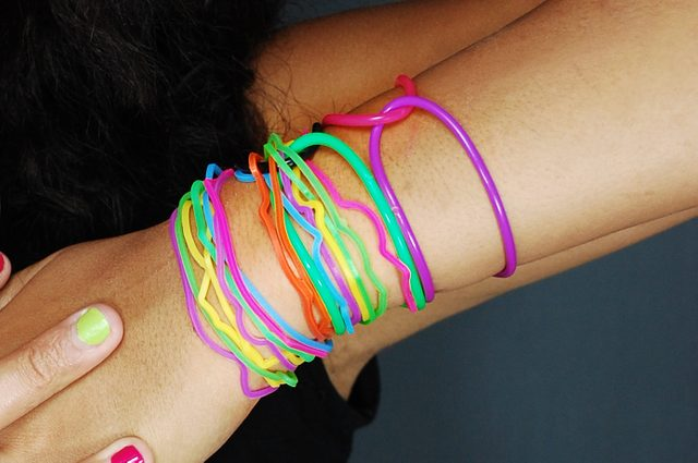 Young female model wearing colorful bracelets/Vibrant Is Always Better