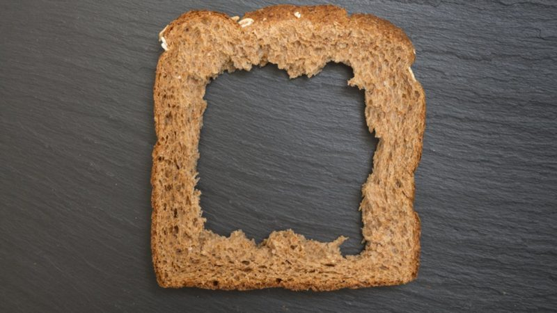 Whole grain sandwich bread slice with hole