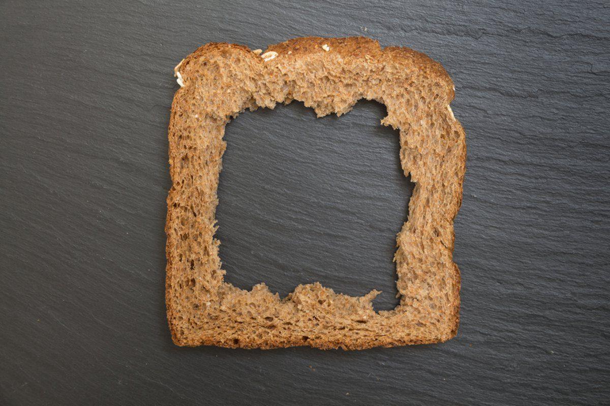 Whole grain sandwich bread slice with hole