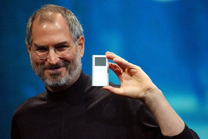 Mandatory Credit: Photo by Marcio Jose Sanchez/AP/Shutterstock (6411790a) JOBS Apple CEO Steve Jobs displays his company's new product, the Mini-Ipod, at the Macworld Conference and Expo in San Francisco APPLE IPOD, SAN FRANCISCO, USA