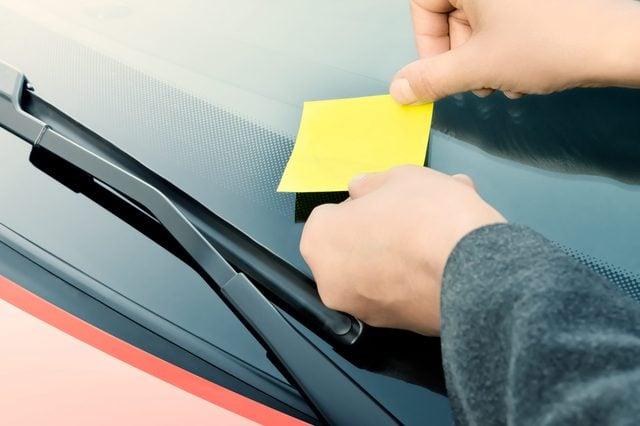 Sticky note on a windshield
