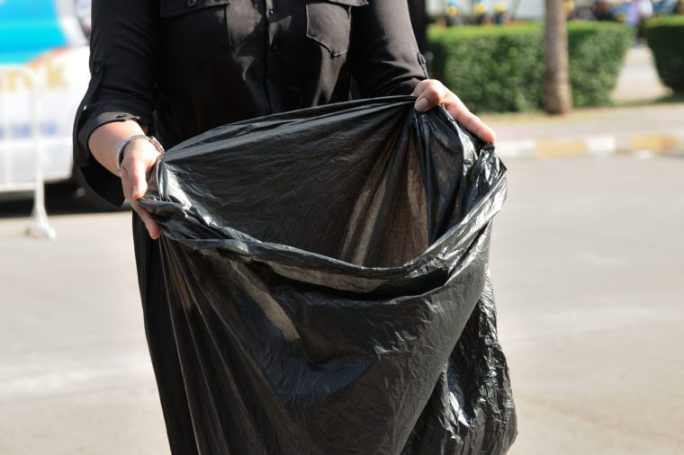 volunteers with black bags to collect garbage.