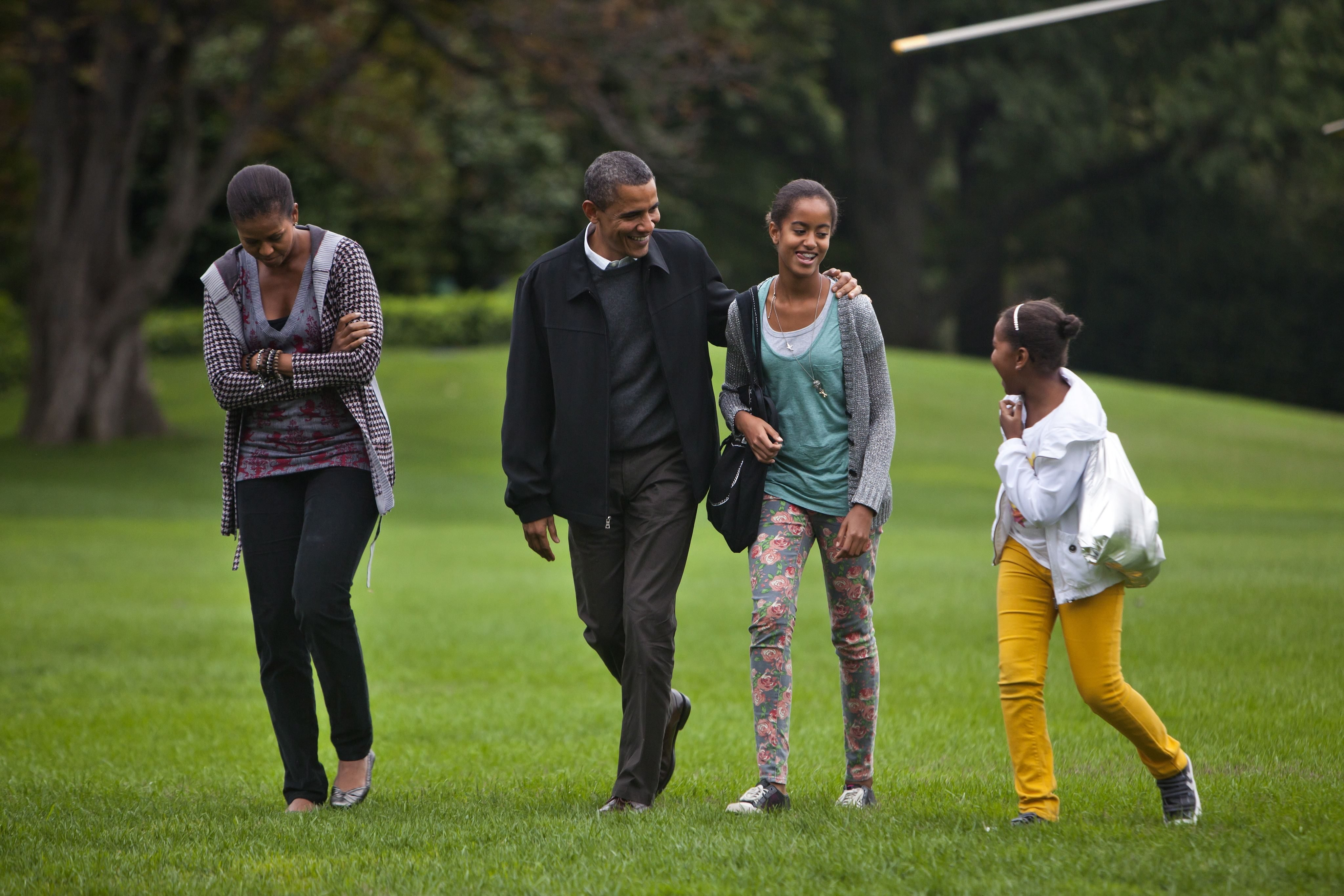 Mandatory Credit: Photo by Jim Lo Scalzo/EPA/Shutterstock (7624580b) U S President Barack Obama with His Wife Michelle and Daughters Malia (under His Arm) and Sasha Returns From Camp David Maryland to the White House in Washington Dc on 03 October 2010 the President's Week Ahead Includes a Meeting with the Economic Recovery Advisory Board As Well As the First Ever White House Summit on Community Colleges United States Washington Usa President Obama Returns White House - Oct 2010
