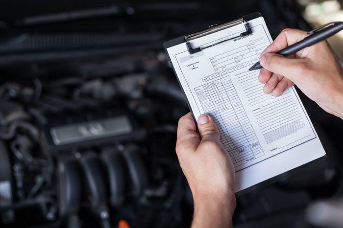 mechanic repairman inspecting car closeup