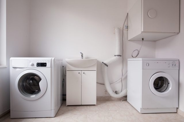 Close-up of automatic washing machines in laundry