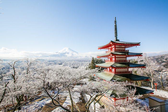 Mt. Fuji with red pagoda in winter, Fujiyoshida, Japan