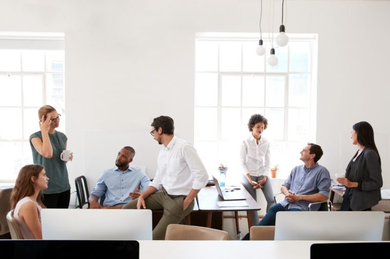 Young business group in discussion in their office