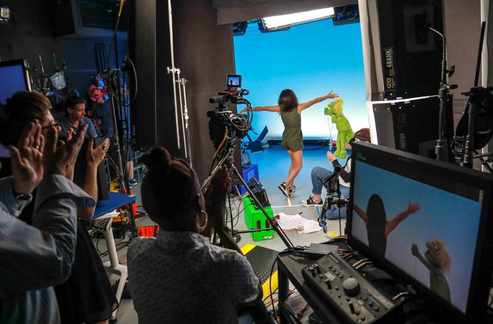 """Mandatory Credit: Photo by Bebeto Matthews/AP/Shutterstock (10440203e) This photo shows production members clapping for Salia Woodbury, 10, left, from Irvine, Calif., on the set with """"Sesame Street"""" muppet Karli and puppeteer Haley Jenkins during a taping about parental addiction in New York. Sesame Workshop is addressing the issue of addiction. Data shows 5.7 million children under 11 live in households with a parent with substance use disorder. Salia's parents are in recovery after struggling with addiction and share her experience with the show's Karli?whose muppet character has a mom who is also in recovery TV-Sesame Street-Addiction, New York, USA - 06 Aug 2019"""