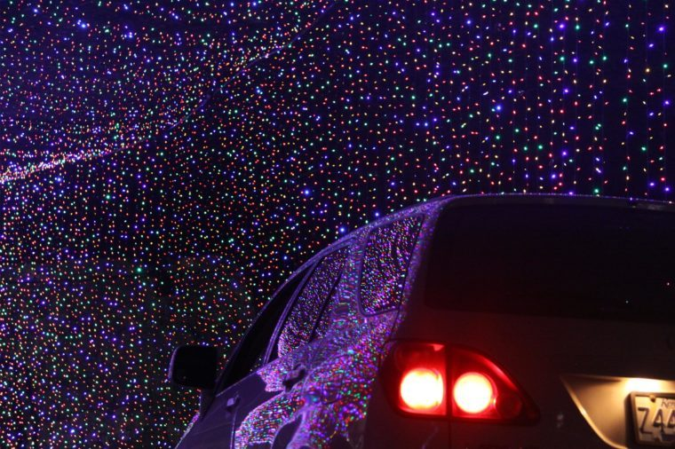 Christmas Lights Under Louisville; Christmas lights reflecting on a car visiting the Kentucky attraction