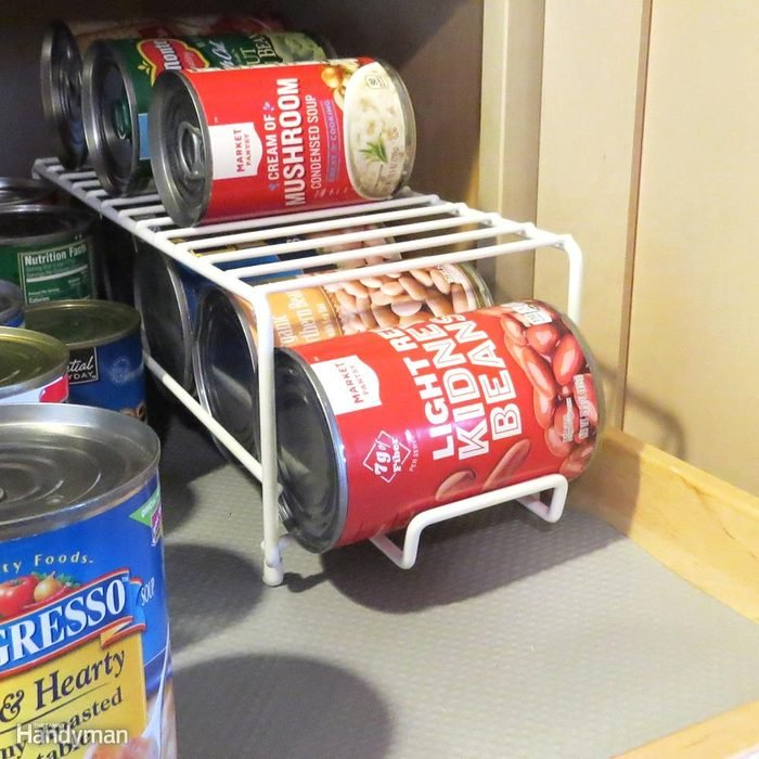 cans of food in pantry storage solution