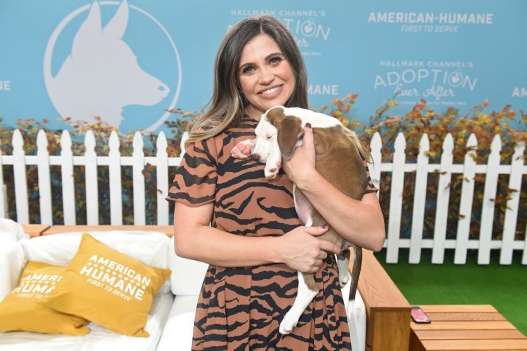 Danielle Fishel is seen holding a dog at the 2019 American Humane Hero Dog Awards at The Beverly Hilton, in Beverly Hills, California