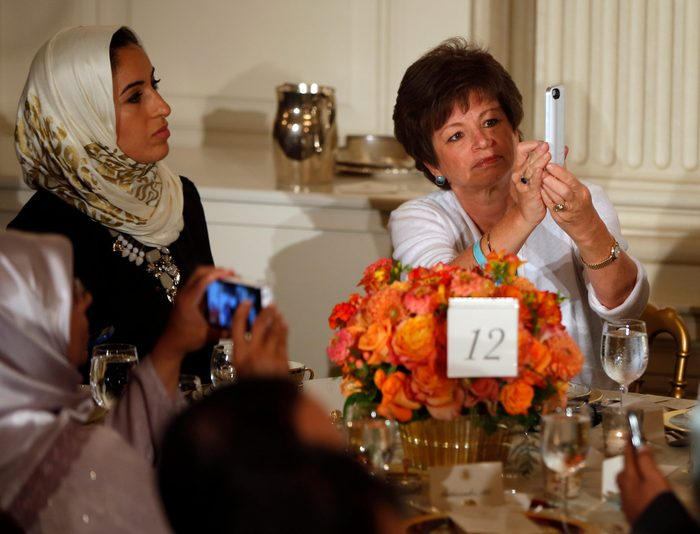 Mandatory Credit: Photo by Charles Dharapak/AP/Shutterstock (5945215a) Valerie Jarrett Senior adviser Valerie Jarrett, right, takes a photograph with her iPhone as President Barack Obama speaks as he hosts an Iftar dinner, which celebrates the breaking of fast during the Muslim holy month of Ramadan in the State Dining Room at the White House in Washington, . Obama also made comments about Syria and the Israel and Palestinian conflict Obama, Washington, USA