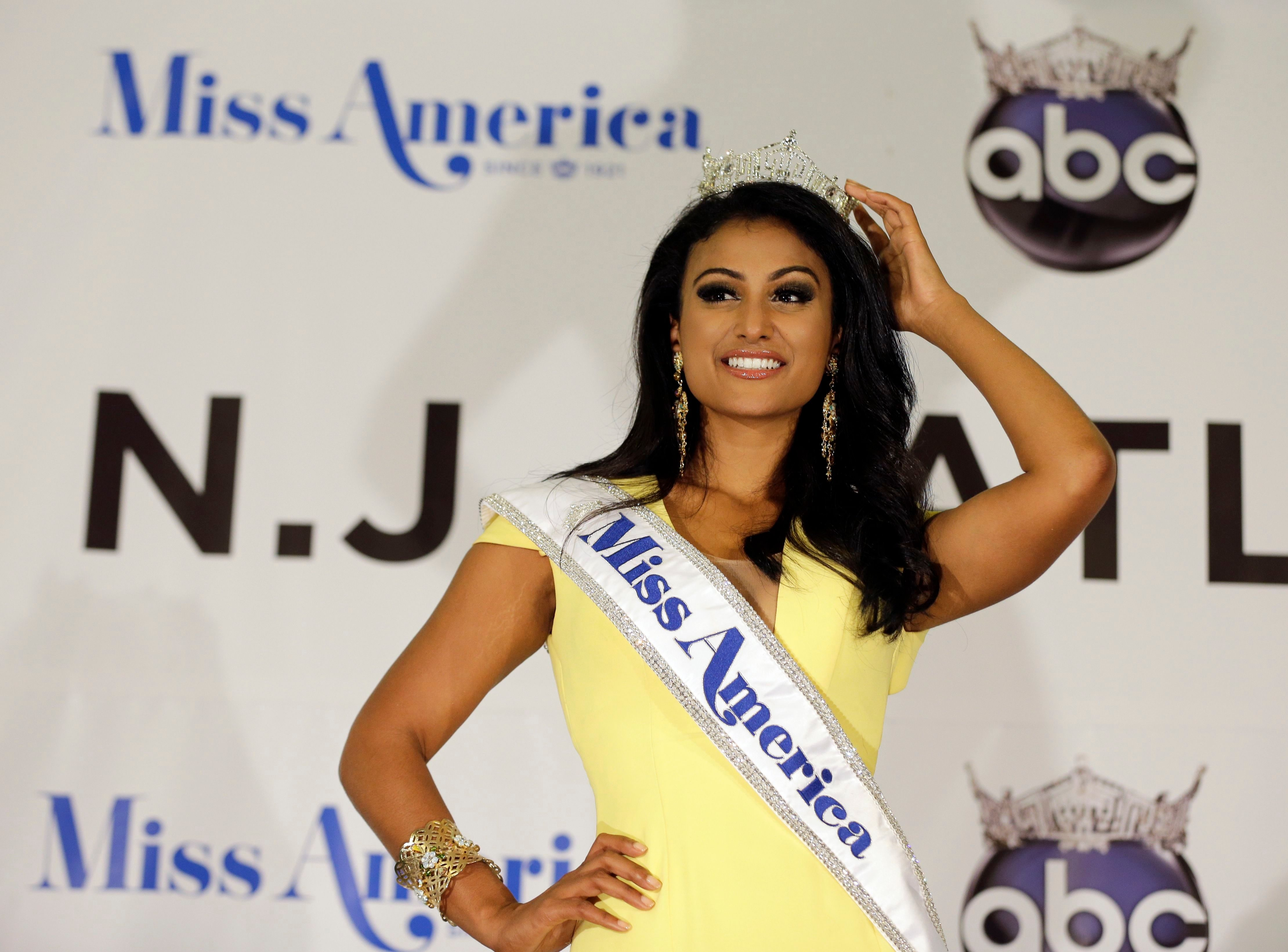 Mandatory Credit: Photo by Mel Evans/AP/Shutterstock (6199142a) Nina Davuluri Miss America Nina Davuluri poses for photographers following her crowning in Atlantic City, N.J. For some who observe the progress of people of color in the U.S., Davaluri's victory in the Miss America pageant shows that Indian-Americans can become icons even in parts of mainstream American culture that once seemed closed Miss America New Kind of Icon, Atlantic City, USA