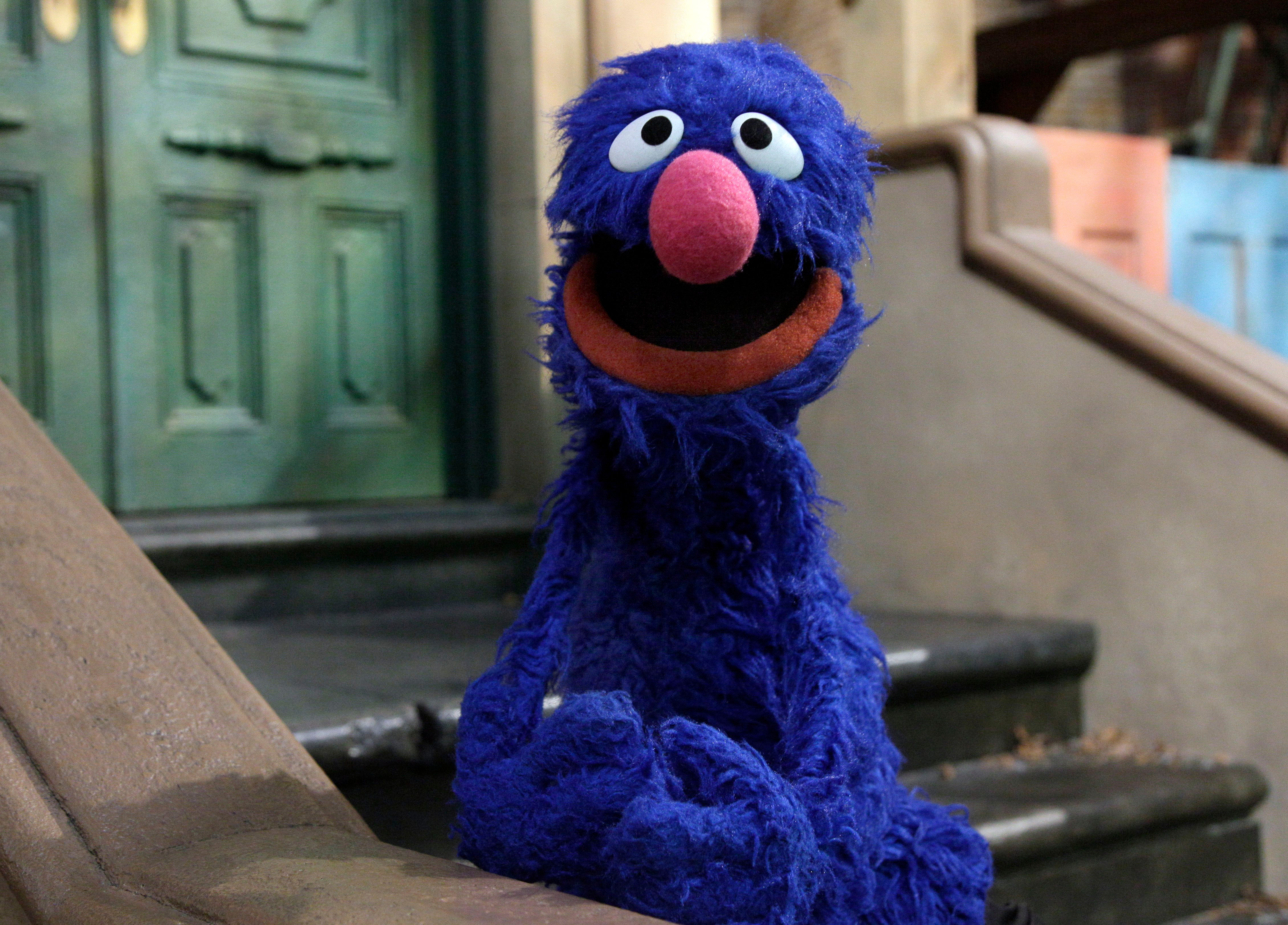 """Mandatory Credit: Photo by Richard Drew/AP/Shutterstock (6287109a) Grover Grover is posed on the set of """"Sesame Street,"""" in New York. Earning money is one of the financial fundamentals that is part of """"For Me, For You, For Later,"""" a new project featuring Grover, Elmo, Cookie Monster and their Muppet pals Family Finance Sesame Street, New York, USA"""