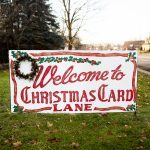 Walk Down Christmas Card Lane, Where Neighbors Decorate with Giant Christmas Cards