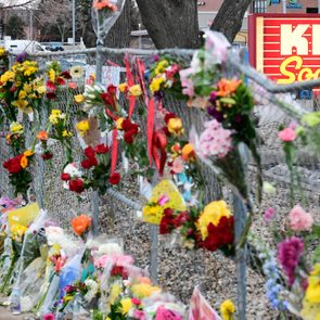 Hundreds of flowers have been placed into the fence surrounding the King Soopers on Table Mesa Drive on March 23, 2021 in Boulder, Colorado.