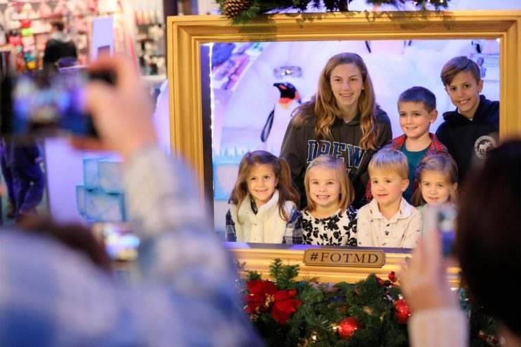 a family enjoys a photo-op at the Kennedy Krieger Institute Festival of Trees