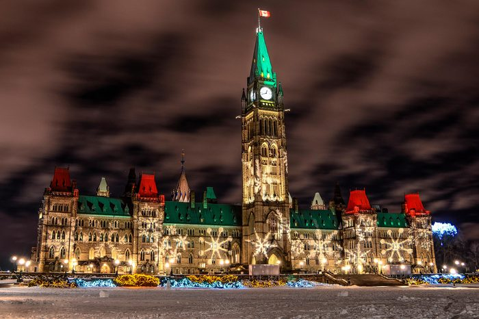 Parliment Hill facade lit up with snowflakes, Ottawa, Ontario