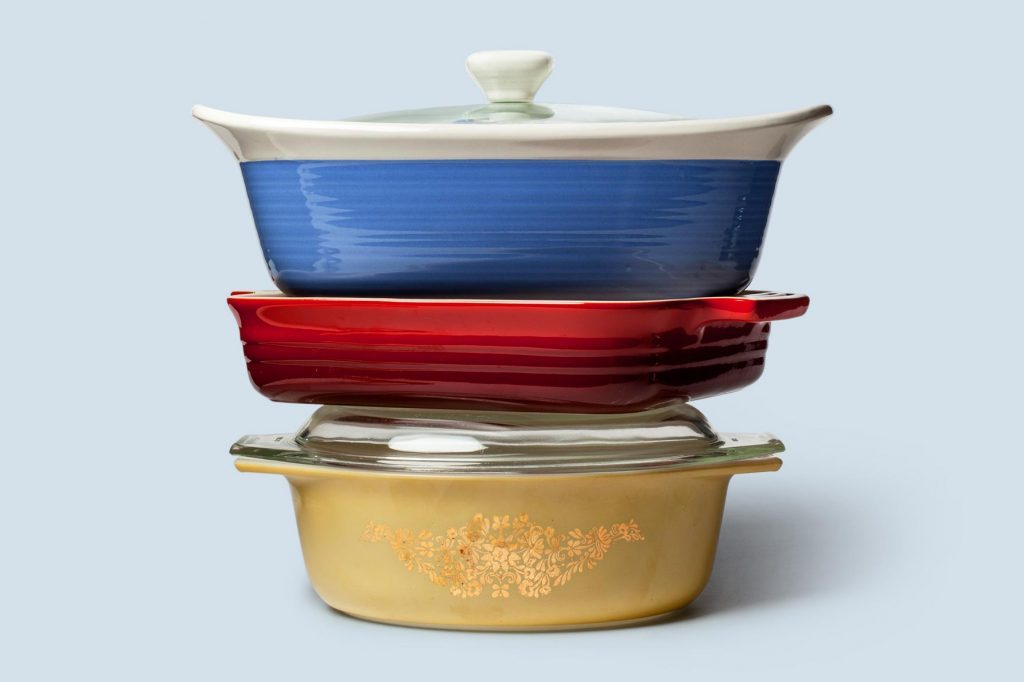 stack of casserole dishes on blue background