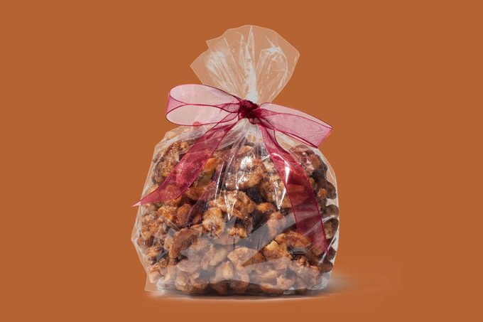 bag of spiced walnuts tied with a bow