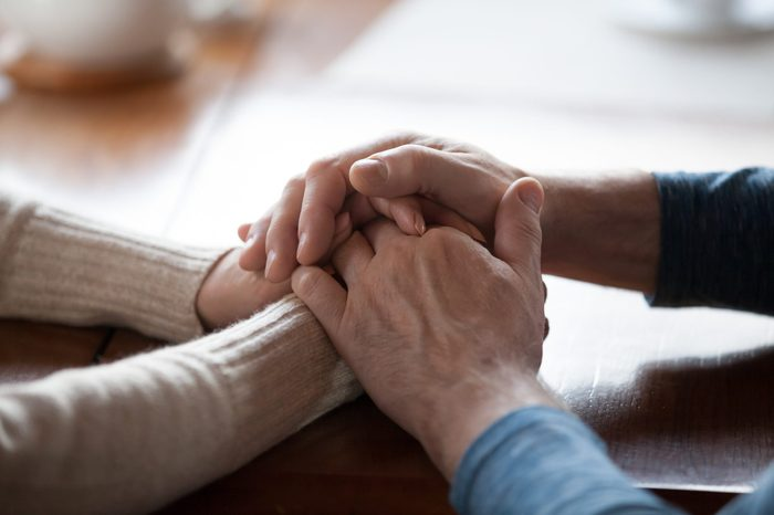 Old middle aged people holding hands close up view, senior retired family couple express care as psychological support concept, trust in happy marriage, empathy hope understanding love for many years