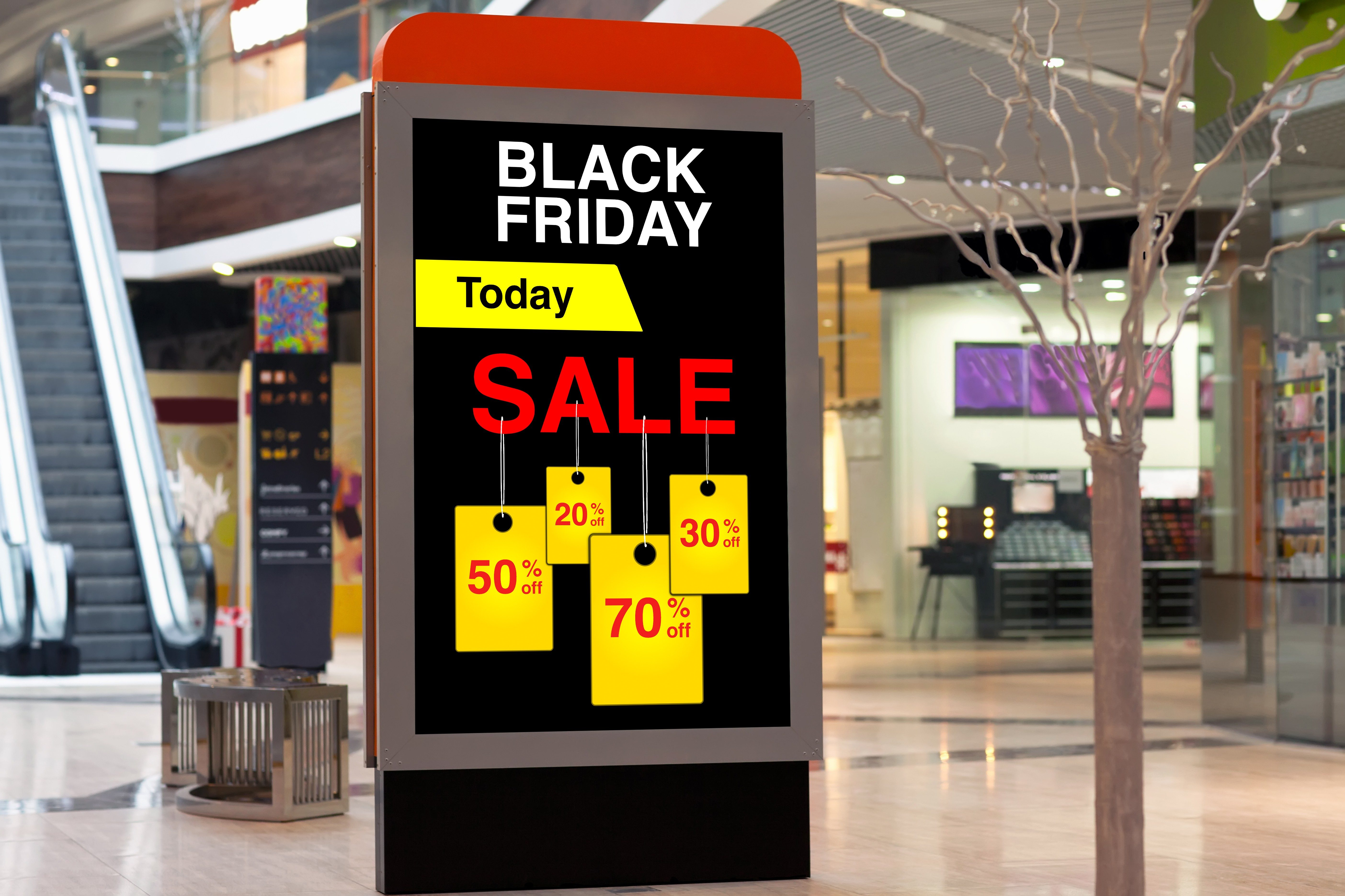 billboard advertising Black Friday and discounts in the middle of large store