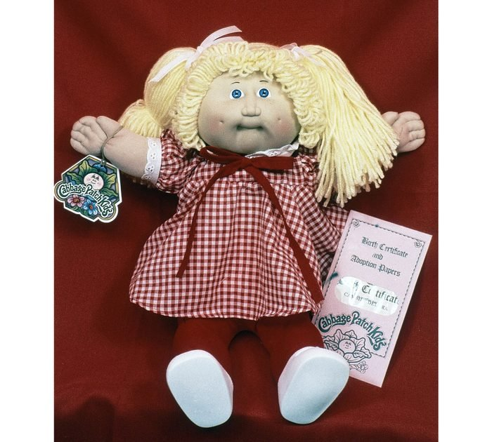 """Mandatory Credit: Photo by AP/Shutterstock (6302228b) A doll created by mountain artist Xavier Roberts, whose """"Little People"""" made him a millionaire, is expanding his line to include the """"Cabbage Patch Kids"""" shown at his home in Cleveland, Ohio, United States in 1983 USA Cleveland International Cabbage Patch Kid, Cleveland, USA"""