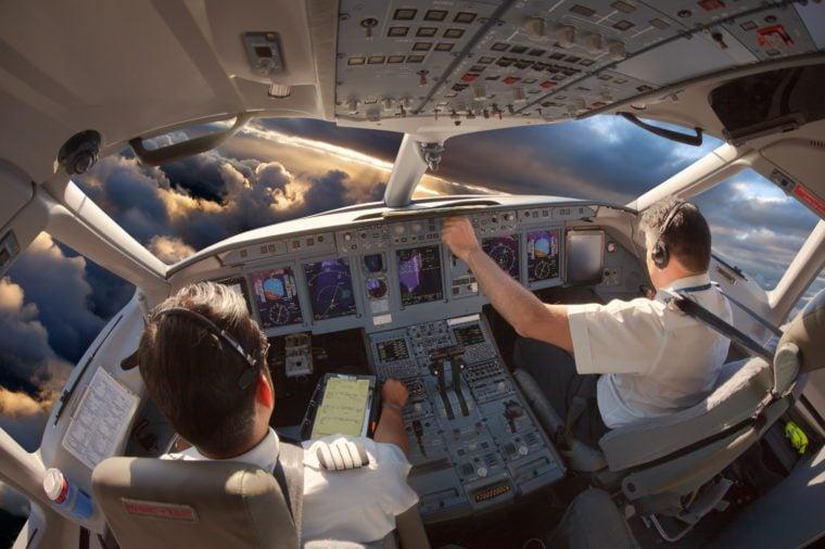 Cockpit of a modern passenger aircraft. The pilots at work.