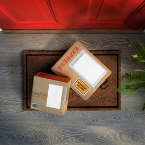 Express delivery boxes outside front door are easy to steal. Overhead view. Add your own copy and label