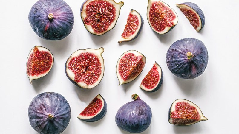 sliced figs on a white background