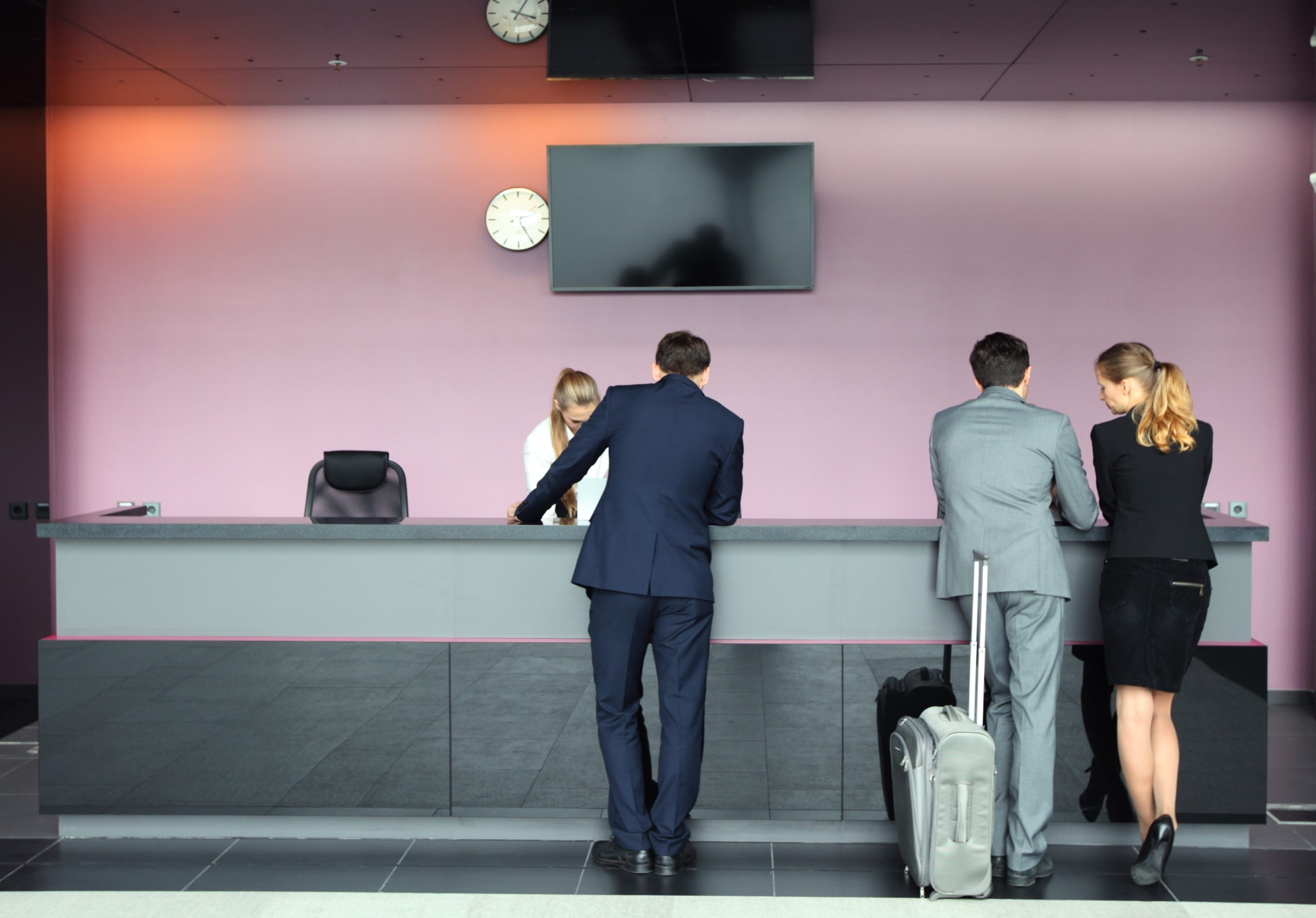 Business people passengers with suitcase waiting for check-in at airport