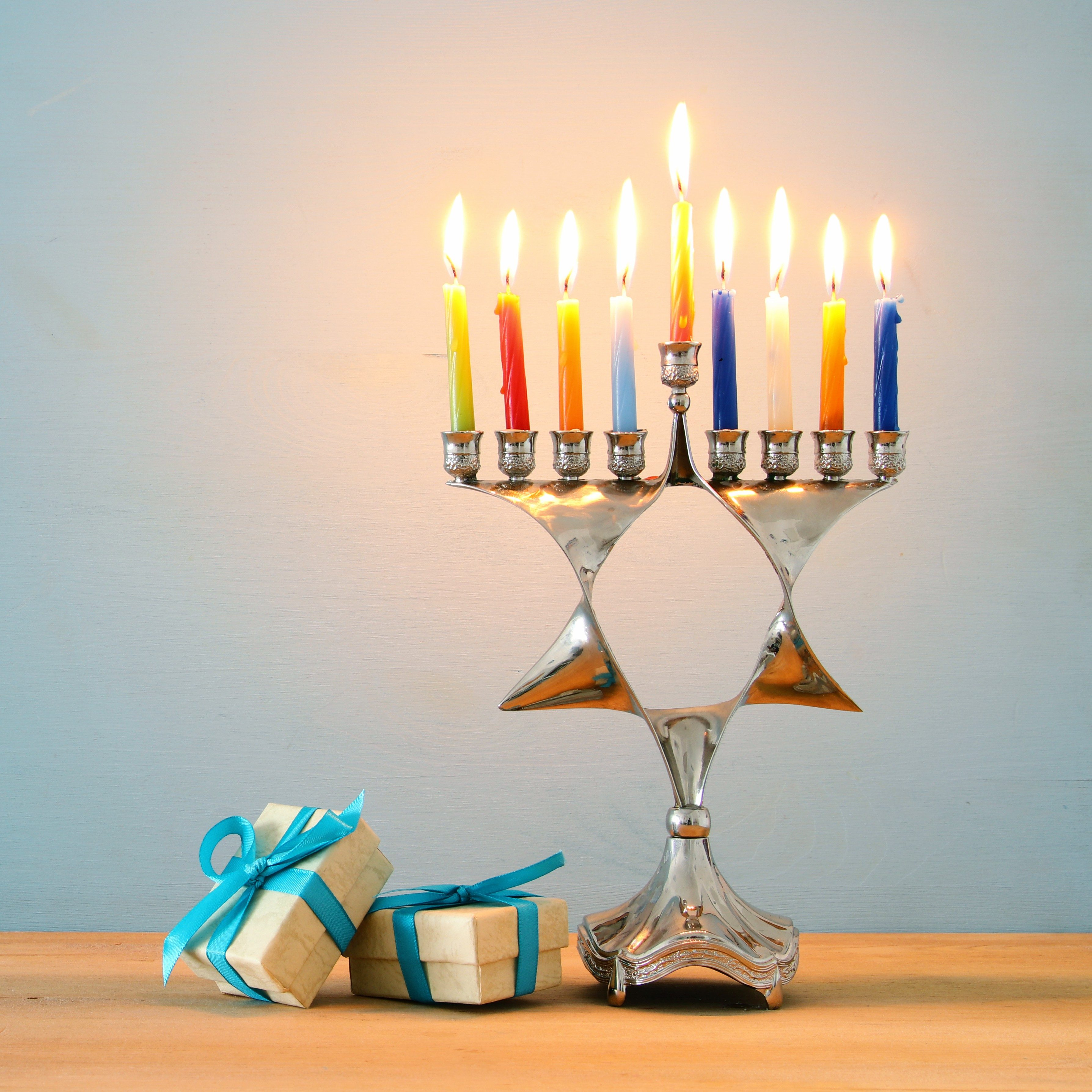 image of jewish holiday Hanukkah background with traditional menorah (traditional candelabra) and burning candles