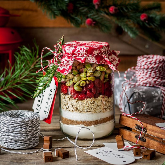 Christmas Cookie Mix in a Jar, Layered Flour, Brown and Caster Sugar, Oats, Dried Cherries and Pistachios, sqaure