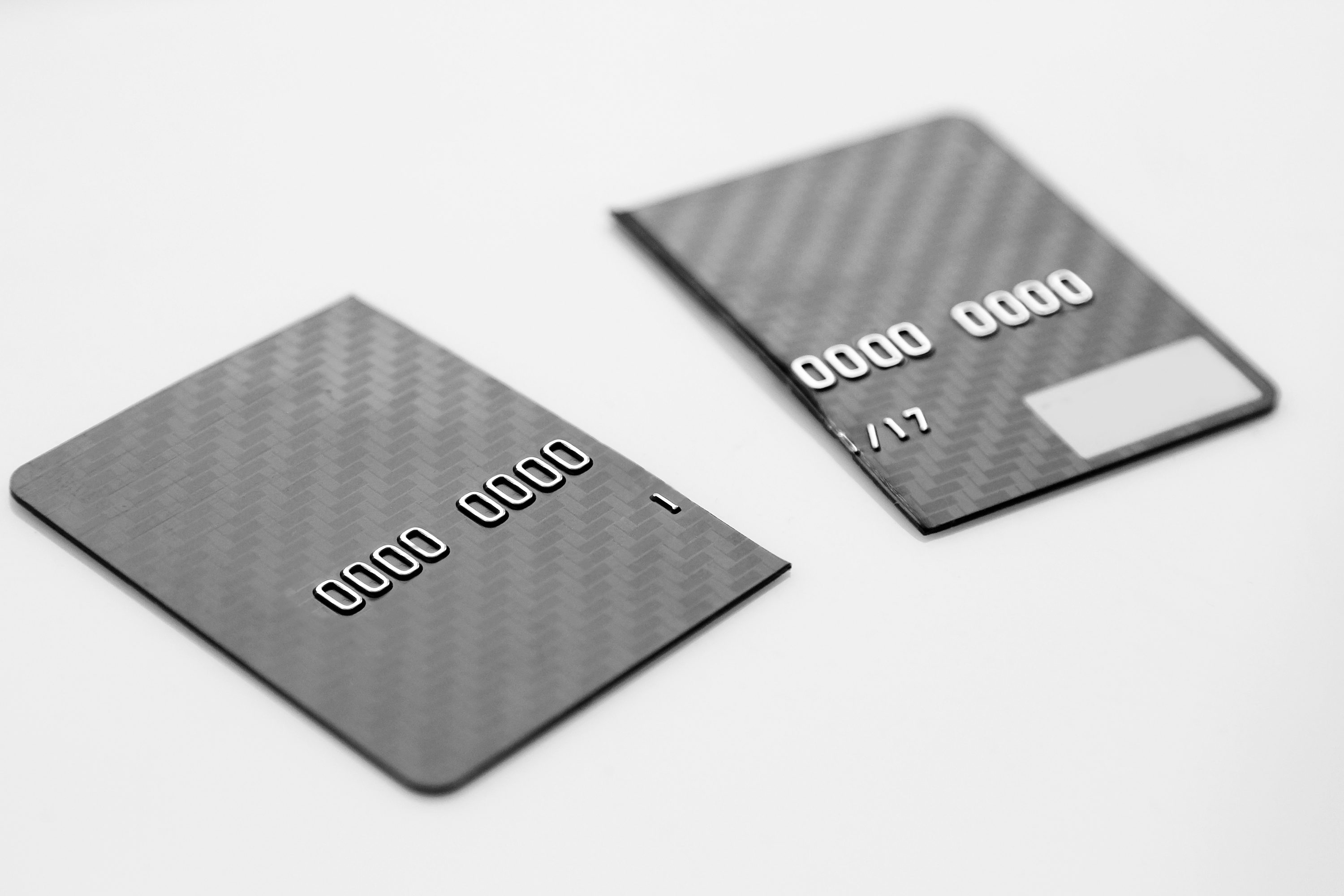 closeup of broken credit card, captured with a small depth of field. Black and white picture