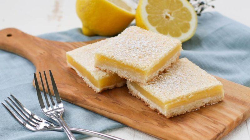 Lemon bars on a cutting board