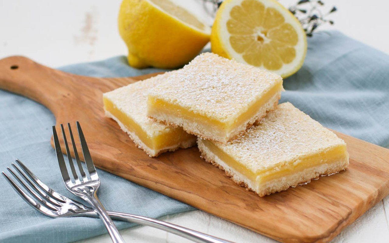 Lemon bars on a cutting board