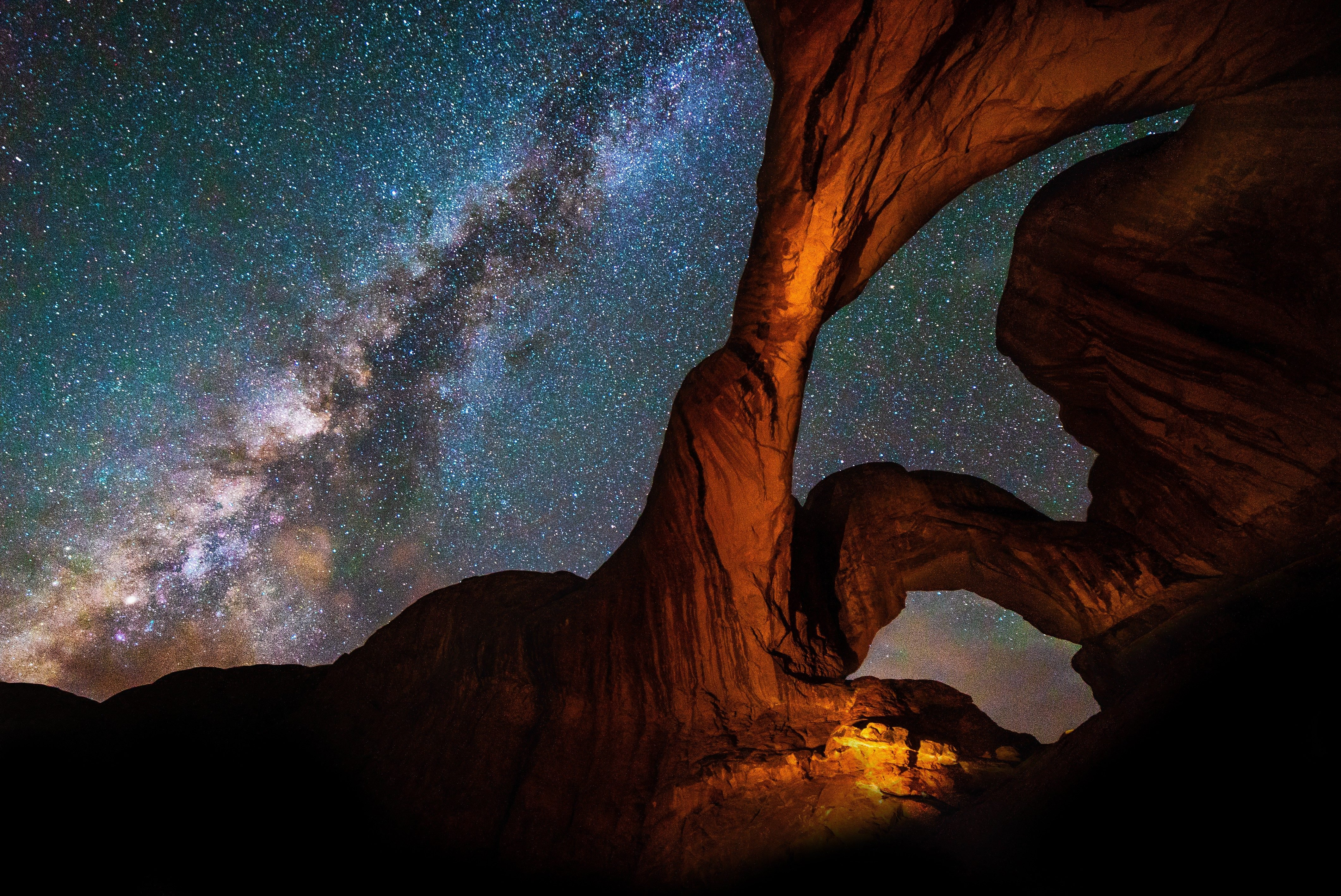 Milky Way Galaxy behind Double Arch sandstone rock formation in Arches, National Park, Utah