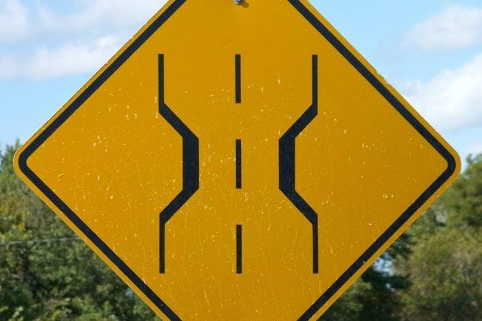 Narrow bridge sign on country road
