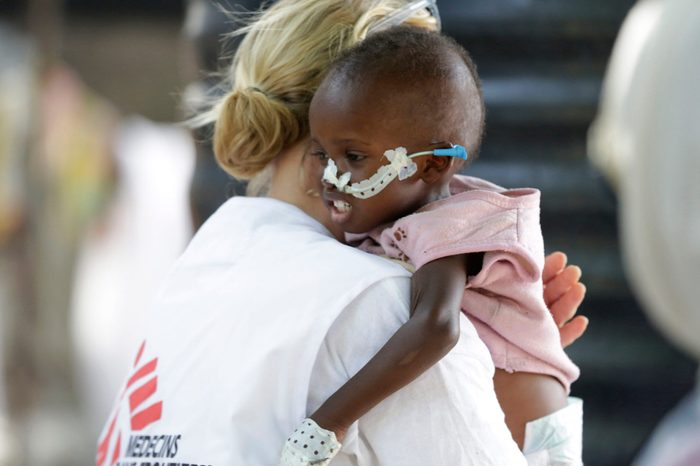 Jean Stowell, an American doctor from Loconia, New Hampshire, running the emergency operation, carries 18 month old Yakubu a malnourished child at a feeding centre run by Doctors Without Borders in Maiduguri, Nigeria.