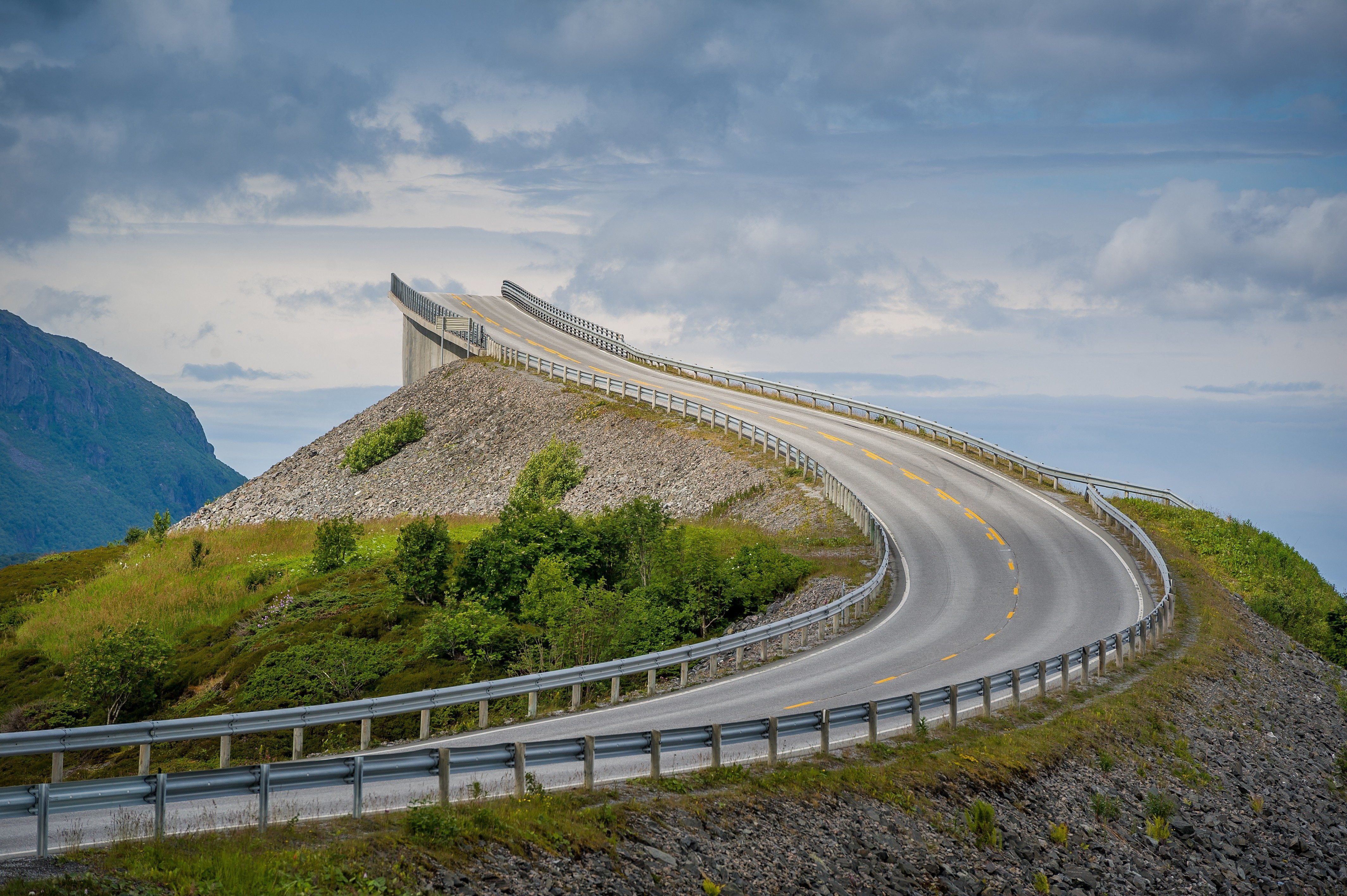 Sun light at empty bridge of norwegian Atlantic Road, one of the most scenic roads of the world. Norway.