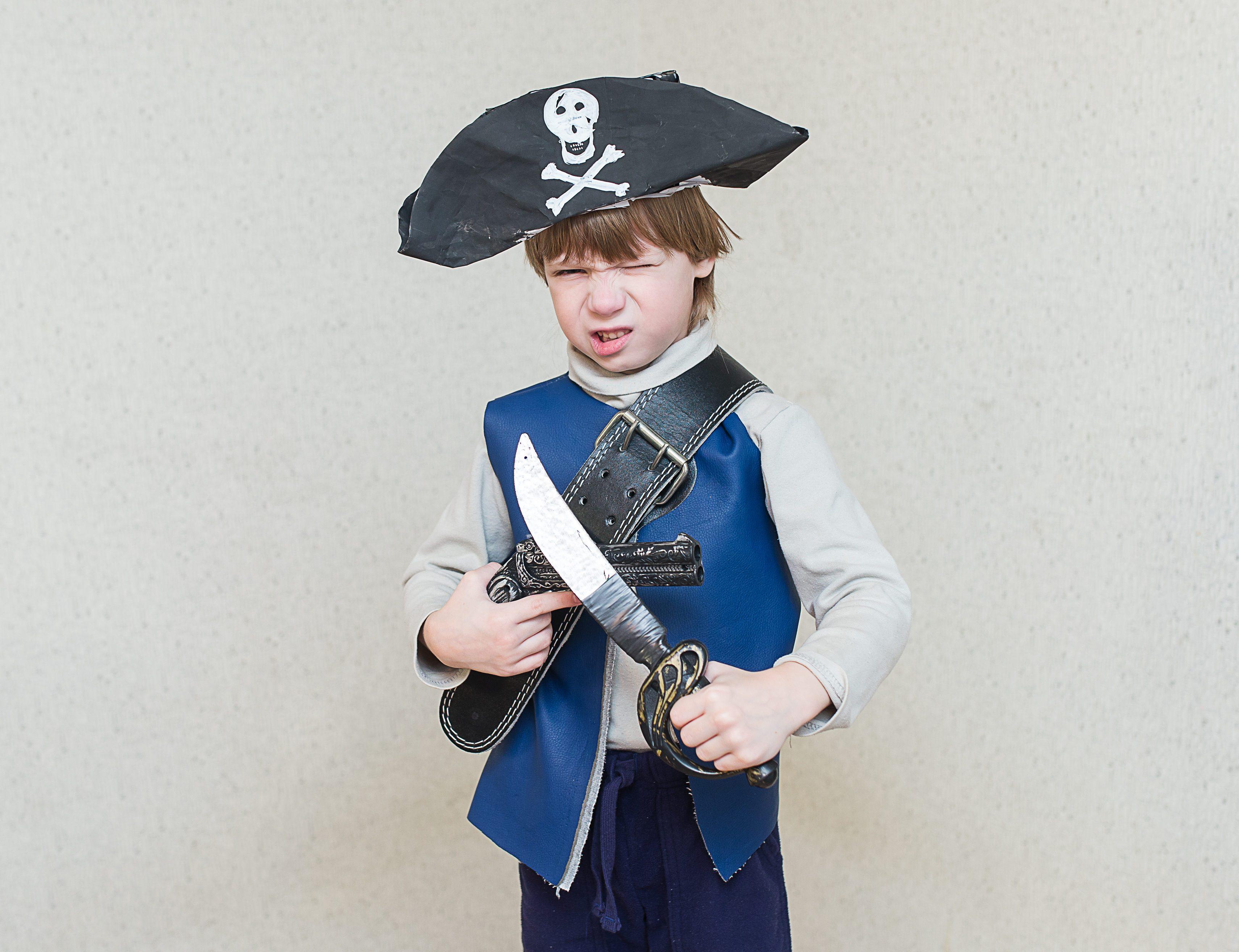 child boy playing pirate.