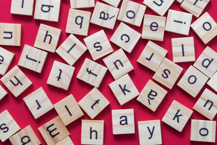 Alphabet letters on wooden scrabble pieces, from above